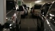 cars and people inside a busy parking garage steadicam