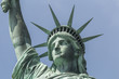 Closeup of Statue of liberty with blue sky in background