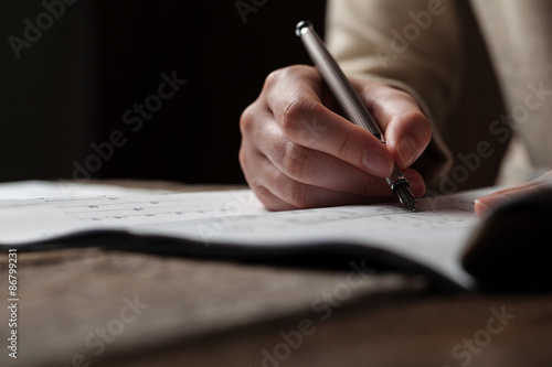 Fototapety, obrazy: woman holding a pen over a house blueprint