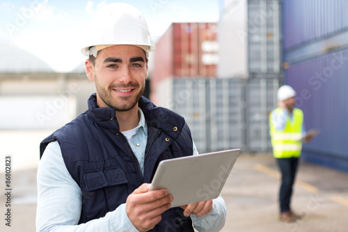 Young Attractive docker using tablet at work