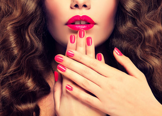 Fototapeta Beautiful girl showing crimson manicure