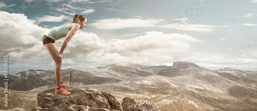 Fotografie, Obraz  Female runner resting on mountain peak