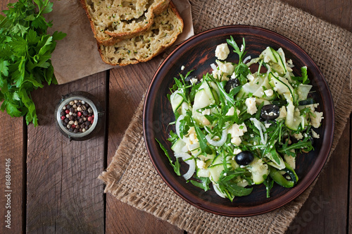 Poster Plat cuisine Zucchini salad with feta, olives and pine nuts