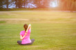 The image with a woman doing yoga in a park