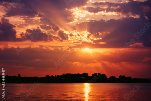 Foto op Canvas Baksteen Retro Effect Of Summer Sunset With Beautiful Cloudy Sky Over Calm Sea Water