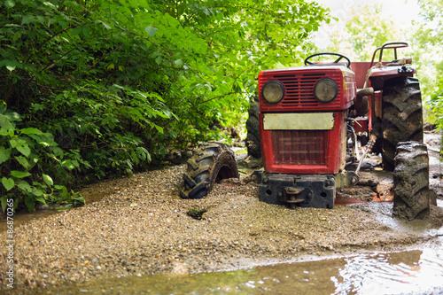 Fotografie, Obraz  Tractor stuck in the mud