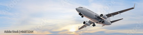 Fotografia Modern Passenger airplane flight in sunset panorama