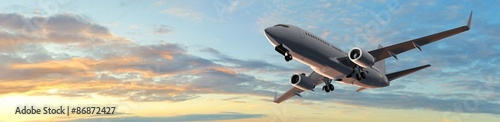 Fotografija  Modern Passenger airplane flight in sunset panorama