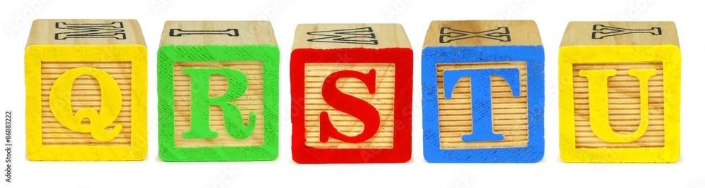 Fototapeta Q R S T U wooden toy letter blocks isolated on white