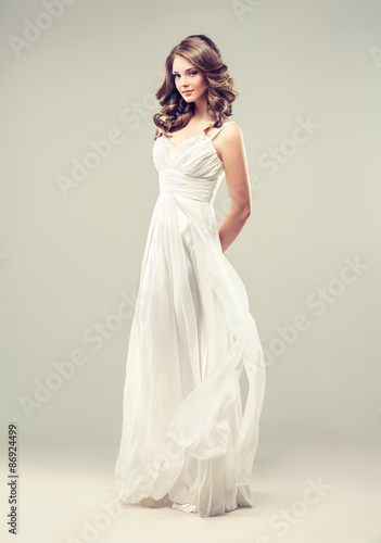 Fotografie, Obraz  Girl model in a white wedding dress with elegant hairstyle