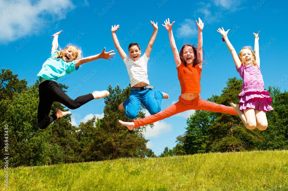 Fototapety, obrazy: Happy active children jumping