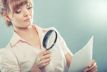 Woman Uses Magnifying Glass To...