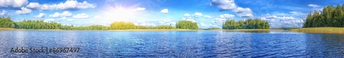 Landscape of beautiful lake at summer sunny day panoramic