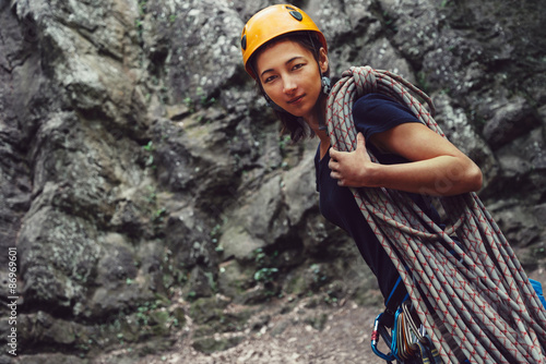 Poster de jardin Alpinisme Climber woman standing with rope outdoor