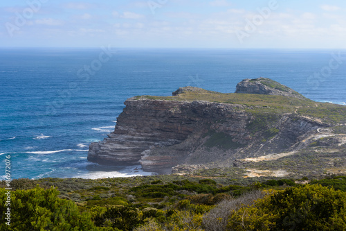 Fotografering  Cape of Good Hope, the southern tip of Africa, because it was once believed to be the dividing point between the Atlantic and Indian Oceans