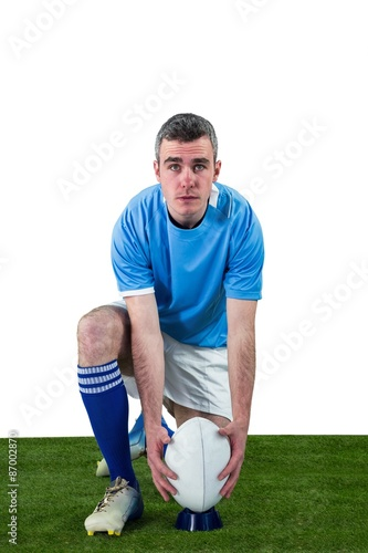 Rugby player ready to make a drop kick - Buy this stock