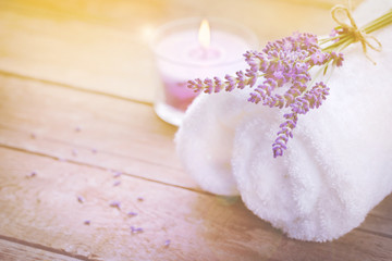 Spa still life with lavender, towel and candle on wood