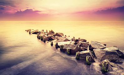Fototapeta 3D Vintage toned beautiful sea landscape after sunset.