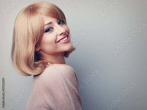 Fotomural Beautiful tooth smiling woman with short blond hair looking happ
