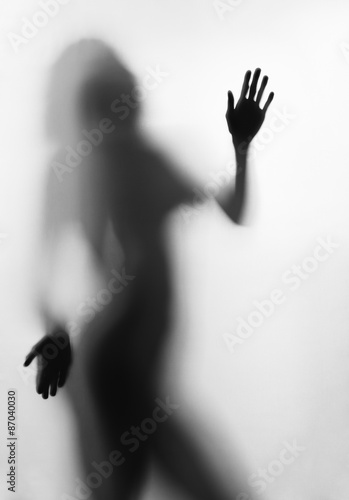 Fototapety, obrazy: Silhouette of young sexy woman