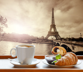 Fototapeta Coffee with croissants against Eiffel Tower in Paris, France