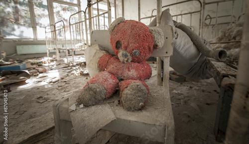 Fotografie, Obraz  Chernobyl - Teddy bear in abandoned kindergarten
