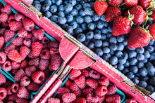 Raspberry, Blueberry And Strawberry On A Farmers Market