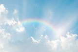 Fototapeta Rainbow - rainbow in the blue sky after the rain with lighting flare