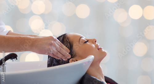 Obraz happy young woman having salon hair wash - fototapety do salonu