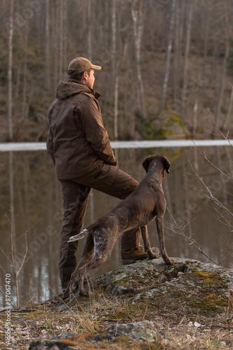 Fotografie, Obraz  Охотник с собакой