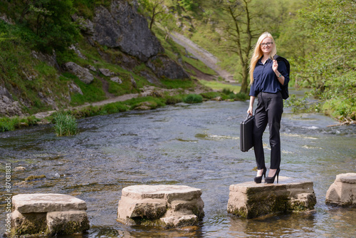 Fotografie, Obraz  young business woman stepping stones to success metaphor
