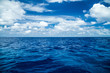 canvas print picture - blue ocean background with blue cloudy sky