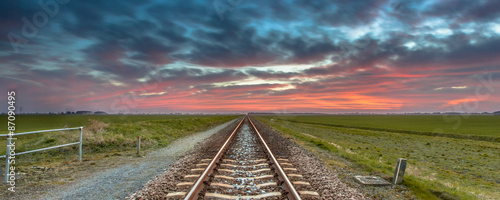 Infinite railroad panorama in open rural countryside