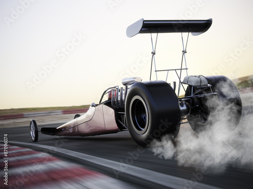 Photo  Dragster racing down the track with burnout