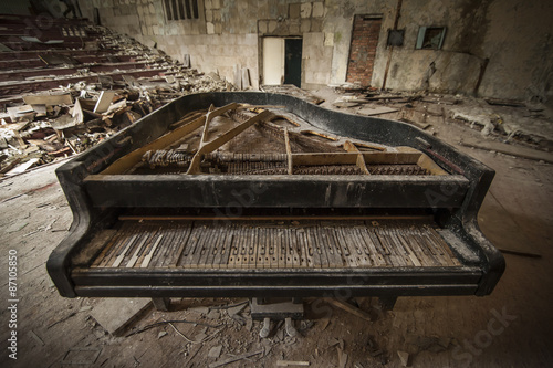 Fotografie, Tablou  Chernobyl - close-up of an old piano in an auditorium