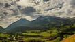 Berner Oberland alpine farmland landscape sunbeams time lapse 4K