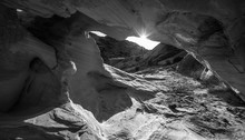 Sun Peeking From Behind The Arch Black And White Abstract Rock F