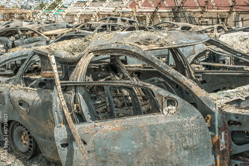 Tuinposter Oude verlaten gebouwen Burned cars after huge fire