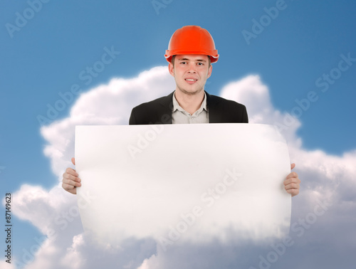 engineer holding blank blueprint paper on clouds buy this stock