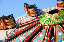 Fairground Ride. An American Fairground Ride In The Style Of The Waltzer Which Is Raising To A Vertical Position.