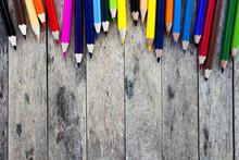 Color Pencils On Wood Plank Ba...