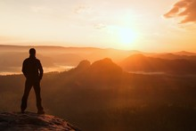 Hiker Stand On The Sharp Corner Of Sandstone Rock In Rock Empires Park And Watching Over The Misty And Foggy Morning Valley To Sun. Beautiful Moment The Miracle Of Nature