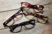 Set Of Reading Glasses On Wooden Background