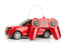 Radio Controlled Car With Controller Isolated On The White Background