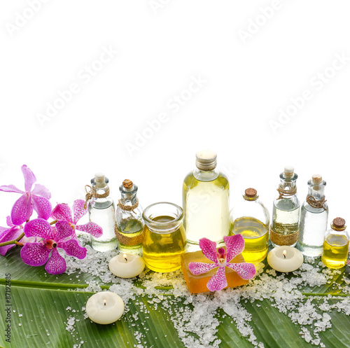Fotobehang Spa spa supplies with orchid,oil, candle on banana leaf