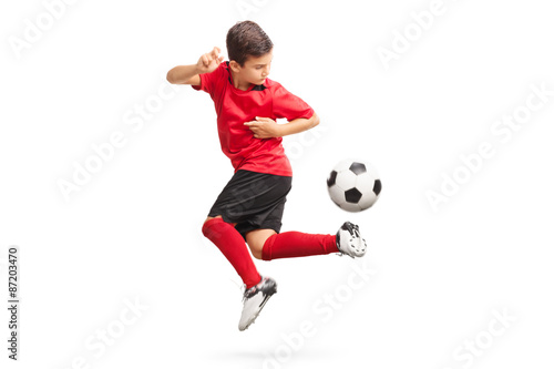 Junior soccer player performing a trick