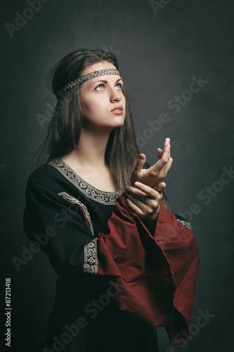 Fotografie, Obraz  Beautiful woman in medieval dress praying