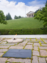 The Eternal Flame On Jacqueline Kennedy's Grave In Arlington National Cemetery In Virginia USA