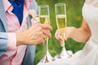 champagne glasses in their hands the bride and groom