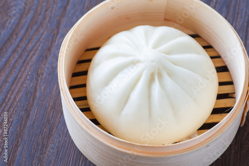 Fényképezés  Traditional chinese cuisines steamed bun in asian style bamboo basket